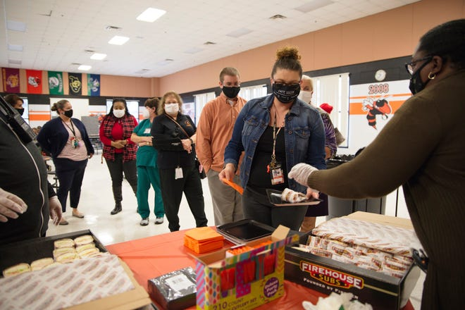 Teachers grab a bite to eat at the Support America's Teachers event at Leesburg High School on Wednesday. [Cindy Peterson/Correspondent]