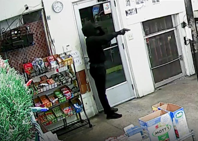New surveillance video released by Mount Dora Police Department shows the moments before the fatal Nov. 30  shooting at T & N Market.