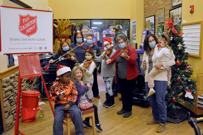 A group of musicians gathered at the Buehler's Fresh Foods in Orrville Tuesday night to play holiday tunes for the Salvation Army bell ringers. From left, Logan leach, Elizabeth Lightfoot, Allison Horst, Emily Horst, Lauren Lightfoot, Nathan Horst, Katie Scarbrough, Esther Horst, Julie Lightfoot and Claire Lightfoot.