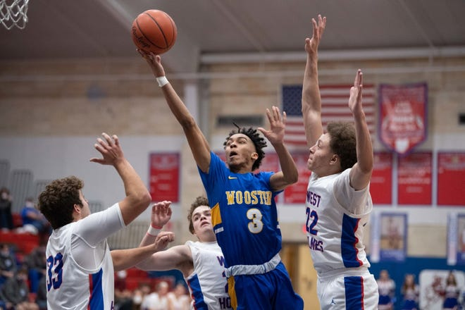Wooster's David Nolen attacks between three West Holmes defenders during a 63-52 win over the Knights. Nolen had a team-high 16 points.