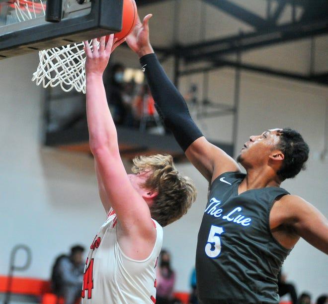 Lutheran East's Jay Billingsley blocks Dalton's Liam Riggenbach. Billingsley, a Georgetown recruit, had 24 points in the win.