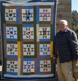 "Charles ""Charlie"" Thomas with his 90th birthday quilt."
