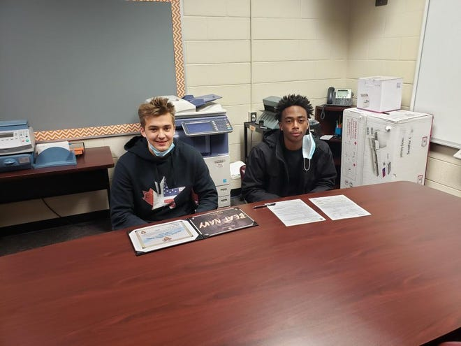 North Davidson's Jake Marion (left) and Jamarien Dalton (right) signed their National Letters of Intent on Wednesday. Marion signed with Army and Dalton signed with Elon.