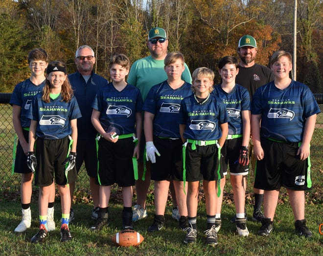 The Reeds Seahawks won the 2020 Davidson County U12 flag football Super Bowl. Team members are (front row, from left) Evan Everhart, Kaleb Peeler, Jonah Tilley, Will Avery, Levi Berrier, Madden Ward, Wyatt Avery; (back row) coaches Jimmy Avery, Andrew Ward and Josh Peeler.