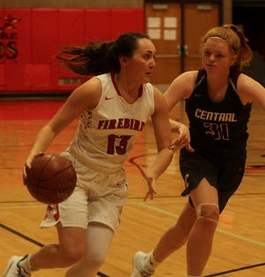 Devils Lake senior guard Malayna Barendt moves past a Grand Forks Central defender in a game against the Knights on Dec. 15 at Devils Lake High School. The Firebirds won 96-40