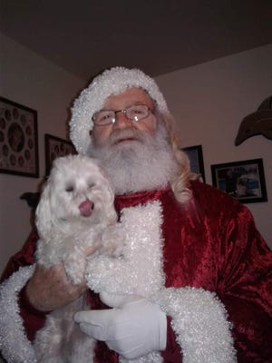 Mac McAnallen of Ellport will again be Santa Claus for the season, providing safe distance visits for local children from his deck this weekend.