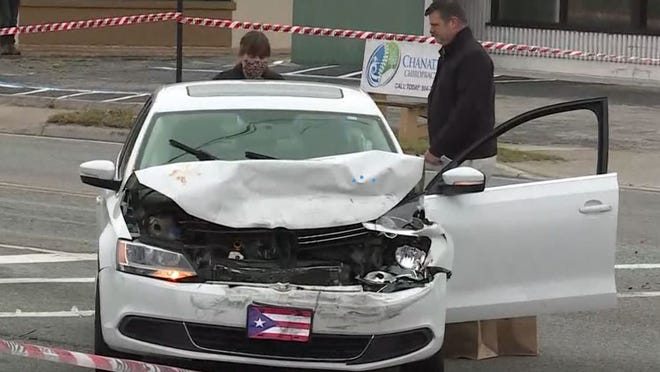 Detectives investigate the crashed stolen car on Merrill Road and Cesery Boulevard that prompted an exchange of gunfire.