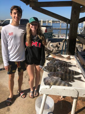 Hilton Ashby and his girlfriend, Emily, caught exactly what they were looking for while fishing with Capt. Kris Kell.