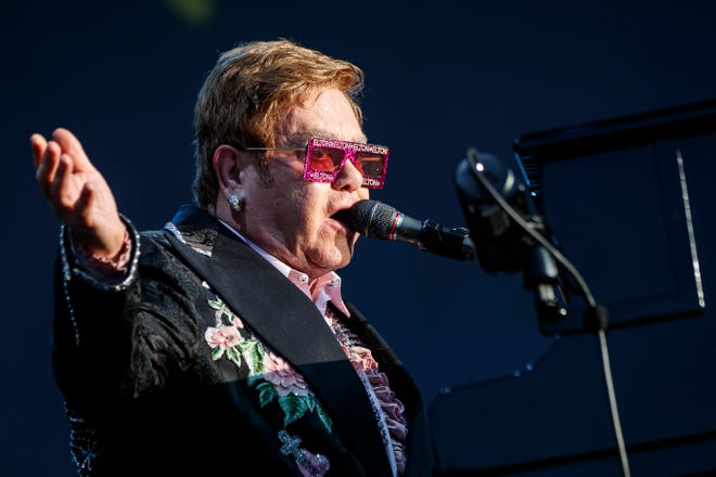 "British singer Elton John performs during his ""Farewell Yellow Brick Road"" tour at the 53rd Montreux Jazz Festival (MJF), in Montreux, Switzerland on, June 29, 2019. Due to the global coronavirus pandemic, concert trade publication Pollstar puts the total lost revenue for the live events industry in 2020 at more than $30 billion. With just a few months on the road, Elton John's ""Farewell Yellow Brick Road Tou"" tops the year's Top 100 Worldwide Tours list with $87.1 million grossed from Nov. 30 through March 7. John's tour ranked No. 2 last year with $212 million grossed. (Valentin Flauraud/Keystone via AP, File)"