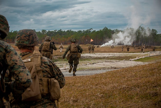 U.S. Marines with 2d Marine Division advance towards an objective during a live-fire assault on range Golf-36 (G-36) at Camp Lejeune, Dec. 12. Range G-36 is the newest addition to the Camp Lejeune training environment and is designed to accommodate company-size assaults and evolutions.