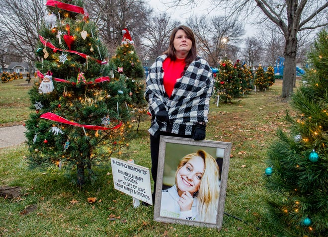 Jenny Justice stands with a portrait of her daughter Annabelle Rodgers, 18, at her memorial Christmas tree at Mineral Springs Park in Pekin. Annabelle died of a likely drug overdose on November 17.