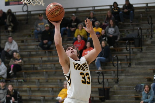 Greem City senior Tristian Herschberger puts up a shot for two points Tuesday against Atlanta.