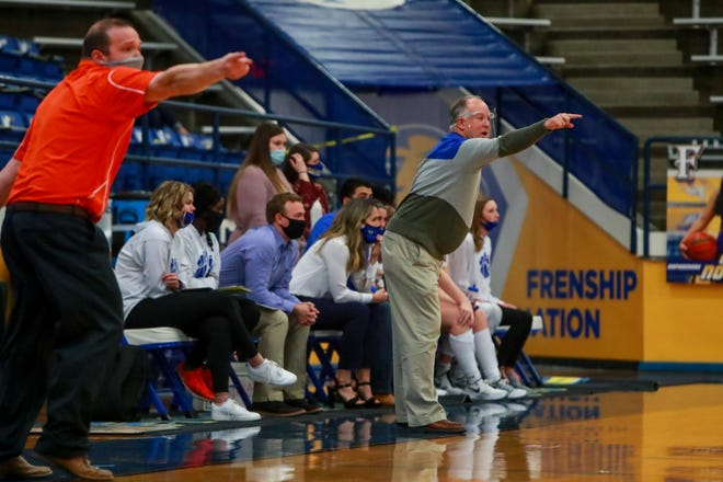 Frenship head coach Trent Hilliard (right) and San Angelo Central head coach Landon Dyer direct their teams on Dec. 15 at the Tiger Pit in Wolfforth, Texas.