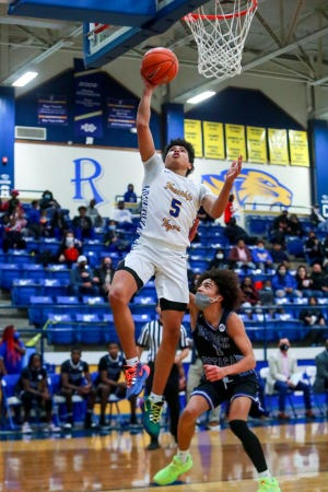 Frenship's Jalen Braziel (5) shoots a layup against Estacado on Tuesday, Dec. 15, 2020, at the Tiger Pit in Wolfforth, Texas.