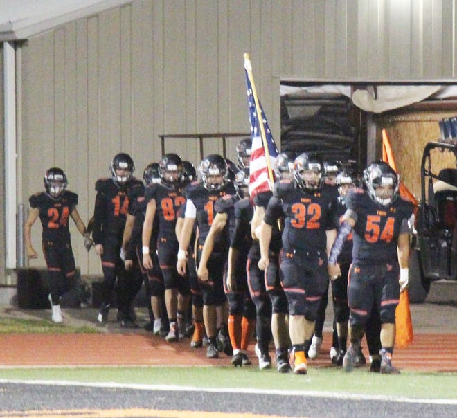 The La Junta High School football team takes the field prior to its game against Pueblo County in October. The Tigers won two games and lost three in 2020.