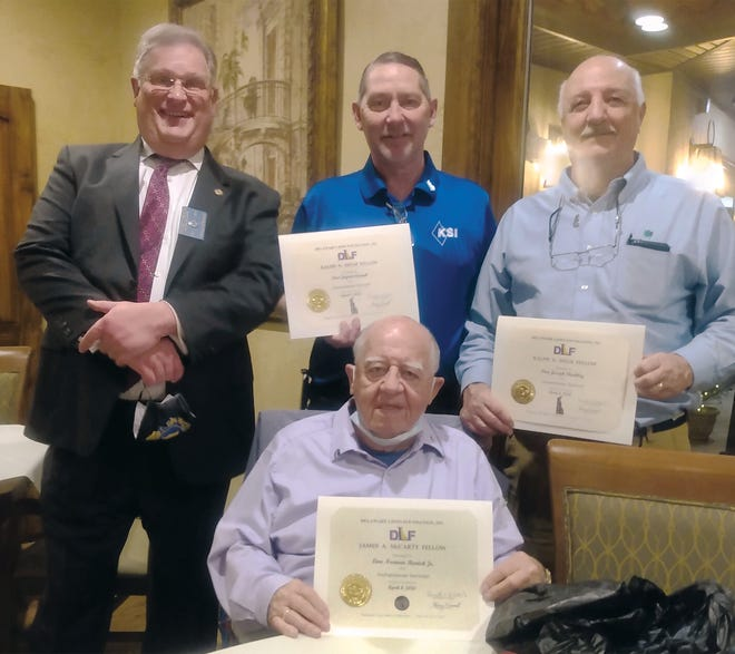 Bruce Hermann, immediate past president of the Milford Delaware Lions Club, left, presented the prestigious recognition awards during the club's Charter Night celebration at Benvenuto in early December. In the photo with Hermann are Kent-Sussex Industries Inc. CEO Jayson Crouch and Joe Shockley, who each received a Ralph Helm Fellowship Award, and Norm Remick, who received a James McCarty Fellowship Award. Not pictured are Bob Voshell, who received a Ralph Helm Fellowship Award; Jean Bielefeldt, who received a James McCarty Fellowship Award; Lloyd Webb, who was recognized as a Knight of the Blind; and Sonny Meck, who was named Lion of the Year.