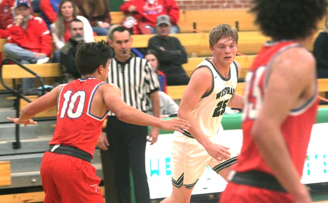 Westran senior guard Caleb Nagel (white jersey) dribbles to his left toward the top of the key. Nagel scored 11 points Tuesday to help the Hornets boys knock off North Shelby of Shelbyville 72-47.
