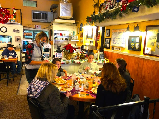 Patty's Place owner Jenny Shedrick waits on members of the Sudore/DeSouza family Wednesday.