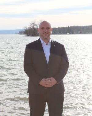 """Michael McNamara, beverage director at The Lake House on Canandaigua, stands beside his """"pretty great office"""" of Canandaigua Lake. """"It's gorgeous out here."""""""
