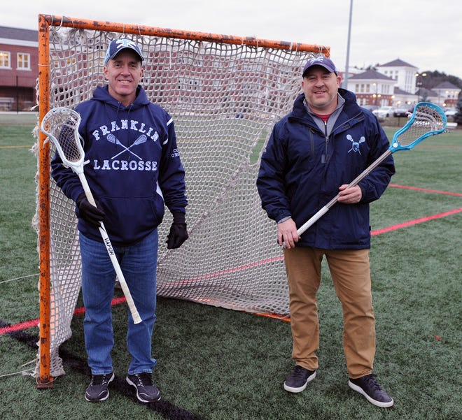 Tom O'Rourke, left, and Pete Davis,  the men behind the Franklin Youth Lacrosse program, at Franklin High School Dec. 16, 2020.
