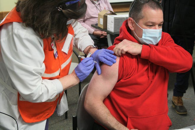 Gary Glatt was among the first Oneida County residents to receive the coronavirus vaccine at St. Luke's Hospital in Utica on Wednesday, Dec. 16, 2020.
