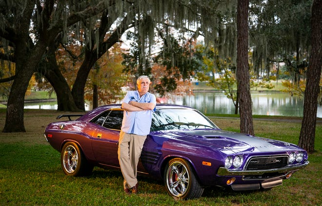 Jem Chapman leans against his 1973 Dodge Challenger at Tuscawilla Park in Ocala earlier this month. He purchased the car about three years ago and took him 2 1/2 years to restore the classic car, even down to the Plum Crazy Purple paint.