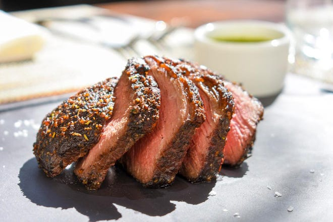 Cuts of Prime beef are featured on Meat Market's extravagant multi-course takeout holiday menus.