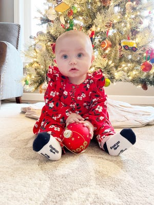 Zoey Louise Ferguson, 7 months old, looks to help decorate the family Christmas tree. Zoey is the daughter of Abby Ferguson of Pontiac. Her grandparents are Kevin and JoAnn Lower and her great-grandmother is Linda Minar, who are all also from Pontiac.