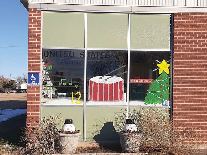 """Mullinville residents Joy Cobb and Brogan Tweedy painted this """"12 Days of Christmas"""" scene on the post office windwow in Mullinville. Other buildings around town feature the other 11 days of the familiar song."""