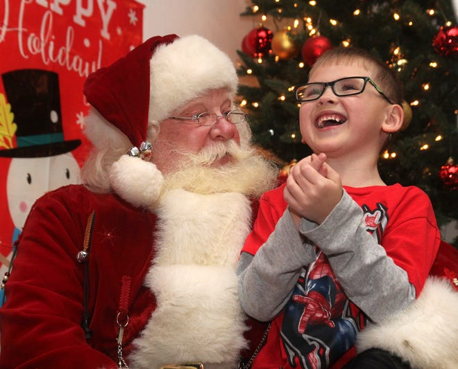 In a photo from 2017, Gabe Johnson, 6,  talks to Santa at the Streetsboro Holiday Lighting Ceremony.