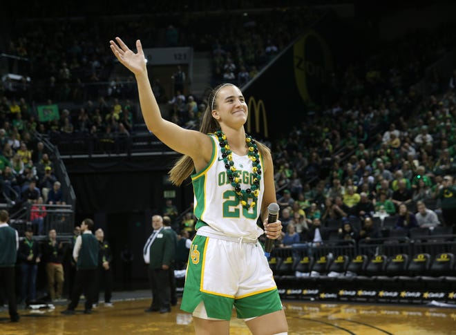 Former Oregon Ducks star Sabrina Ionescu waves to the sold-out crowd during her senior day ceremony last year at Matthew Knight Arena.
