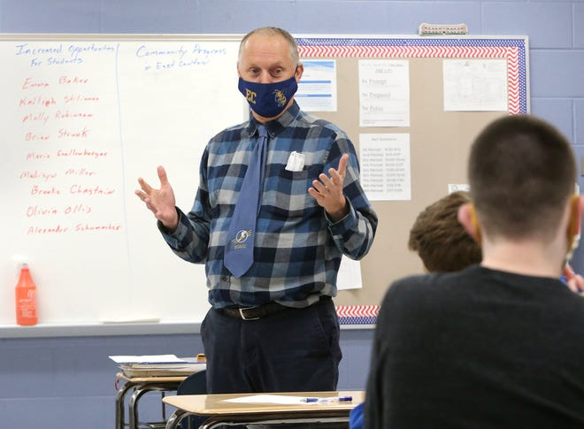 Tom Loy teaches his class at East Canton High School on Wednesday. Osnaburg Local is giving all of its employees a $500 bonus as a thank you for the extra steps they have taken to support students during the coronavirus pandemic.