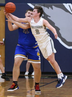 Dawson Fortner (right) of Fairless steals the ball from Ethan  Collins (42) of East Canton during their game at Fairless on Tuesday, Dec. 15, 2020. 42 2