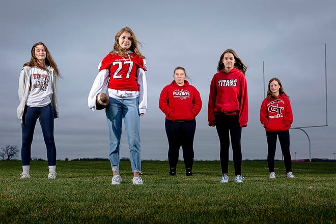 Chatham Glenwood High School junior Riley Garrett, left, Glenwood High School senior Arianna Mills, and junior high players, Addison Lindvall, Caroline Cody and Mia Gerger, right, are a group of female football players within the Glenwood football program. [Justin L. Fowler/The State Journal-Register]
