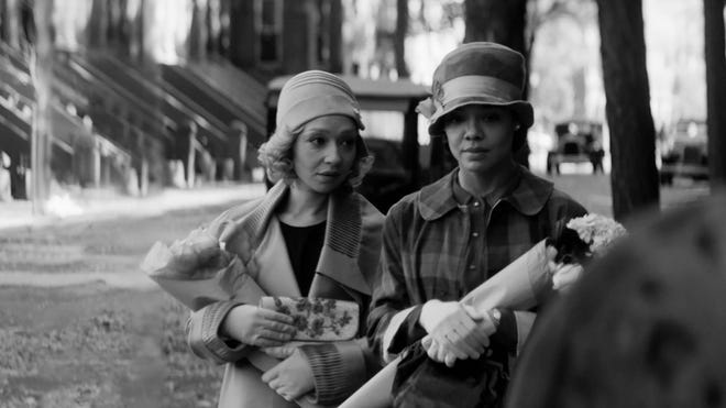 "Ruth Negga, left, and Tessa Thompson appear in ""Passing"" by Rebecca Hall, an official selection at the 2021 Sundance Film Festival. (Edu Grau/Sundance Institute/TNS)"