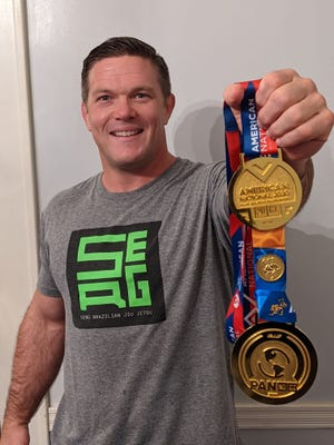 Savannah native and resident Michael Sergi holds two gold medals he recently earned in martial arts at major tournaments in Atlanta and Dallas.