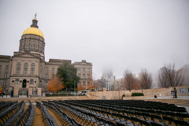 A thousand empty chairs sit in front of the Georgia Capitol to honor the thousands of Georgians lost to COVID-19.