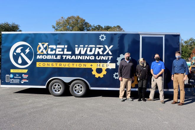 Several Savannah businesses have stepped up to held sponsor the Xcel Strategies  HVAC, electrical and plumbing trailer, which includes work stations to demonstrate real-world tasks and duties in the various industries. Pictured left to right are Chat Howard, Sandpiper Supply, Sherry Daniel and Kyle Hagemes of Roto-Rooter Plumbers of Savannah and Jay Thompson of Xcel Strategies. [Photo courtesy of Roto-Rooter Plumbers of Savannah]