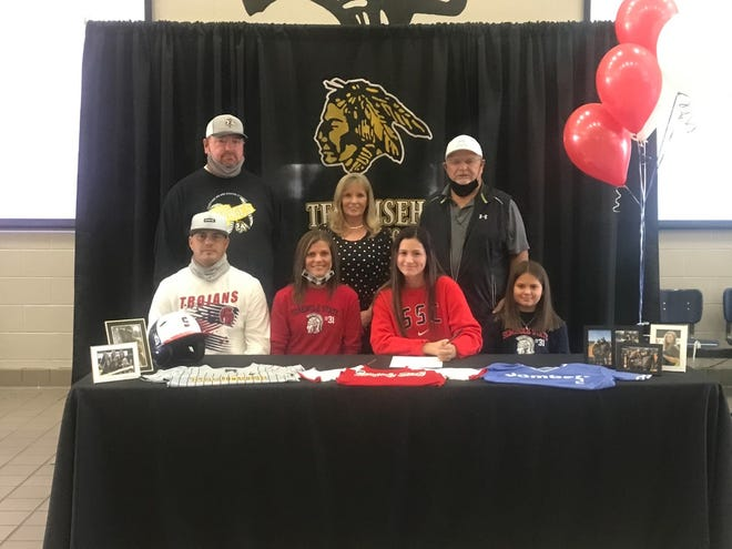 Tecumseh High School softball standout Ayzia Shirey (seated second from right) recently signed a letter-of-intent to play at Seminole State College in 2021-2022.