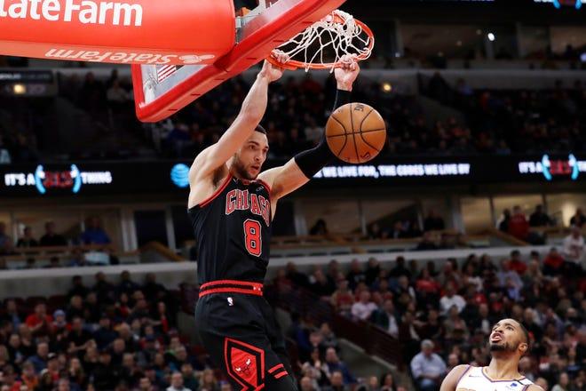 In this Saturday, Feb. 22, 2020, file photo, Chicago Bulls guard Zach LaVine dunks against the Phoenix Suns.