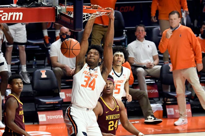 Illinois center Jermaine Hamlin (34) dunks the ball against Minnesota  Tuesday in Champaign.