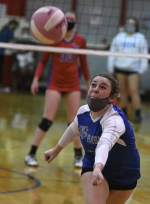 Trask's Emily Thomas runs down a ball during a conference volleyball match at Pender High School in Burgaw, N.C., Tuesday, December 15, 2020. [MATT BORN/STARNEWS]