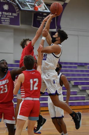 Topeka West's Trevion Alexander attempts a floater during Tuesday night's game against Shawnee Heights at Topeka West. Alexander scored 28 points in the Chargers' 70-69 double-overtime victory. [Rex Wolf/Special to The Capital-Journal]