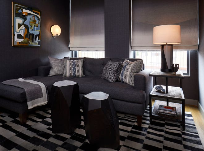 This image provided by John Eason shows a media room by Eason, a New York interior designer.