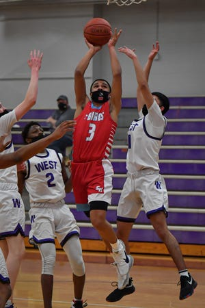 Isiah Johnson (3) is averaging 30.5 points per game for Shawnee Heights this season, but will miss the next two weeks after testing positive for COVID-19.