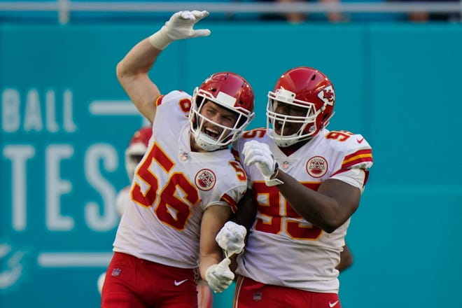 Kansas City Chiefs outside linebacker Ben Niemann (56) and defensive tackle Chris Jones (95) celebrate after Jones sacked Miami Dolphins quarterback Tua Tagovailoa in the end zone for a safety during the second half Sunday, Dec. 13, in Miami Gardens, Fla. [Lynne Sladky/The Associated Press]