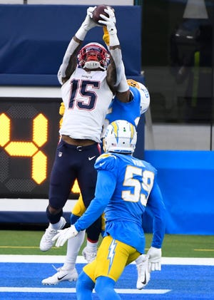Patriots wide receiver N'Keal Harry leaps to grab a 5-yard touchdown pass against the Chargers in Week 13.