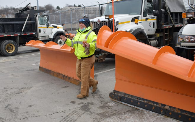Driver Jennifer Fair is taking the storm prediction in stride. Fair parked her plow truck and sipped an ice coffee. The public works garage was busy Wednesday as drivers prepared trucks for the storm slated to begin Wednesday night.