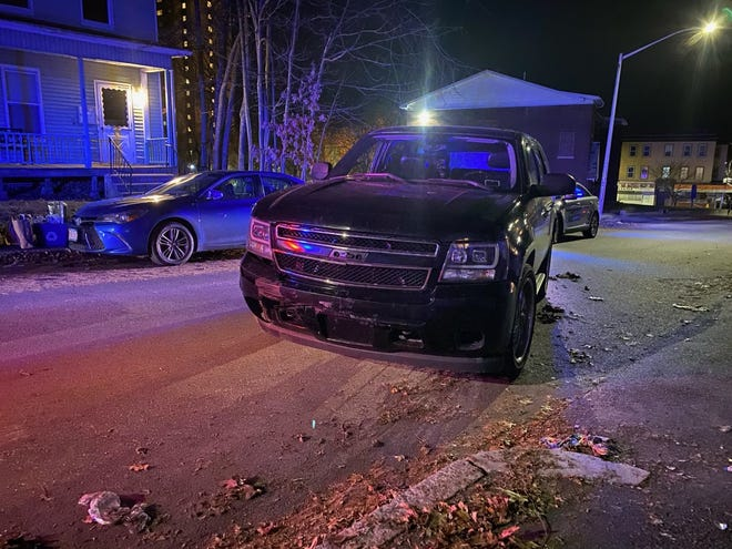 A damaged vehicle sits across Russell Street Tuesday..