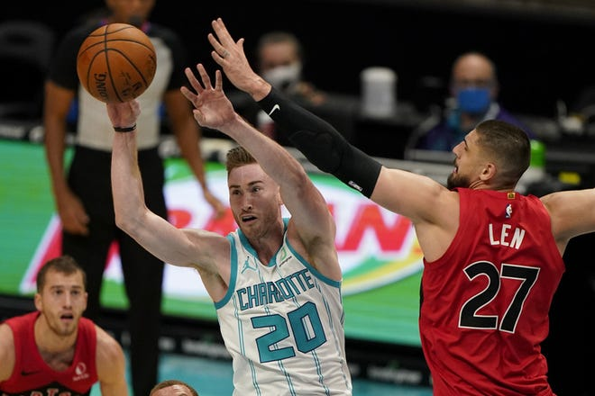 Charlotte forward Gordon Hayward passes around Toronto center Alex Len during a recent preseason game.